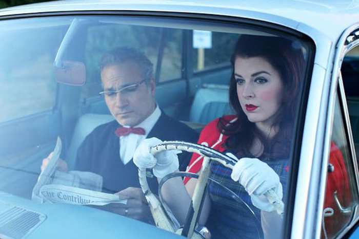 A couple wearing vintage clothes driving a car - Christmas photo cards