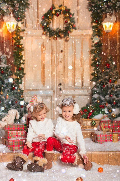 Sweet christmas portrait of two kids posing in snow