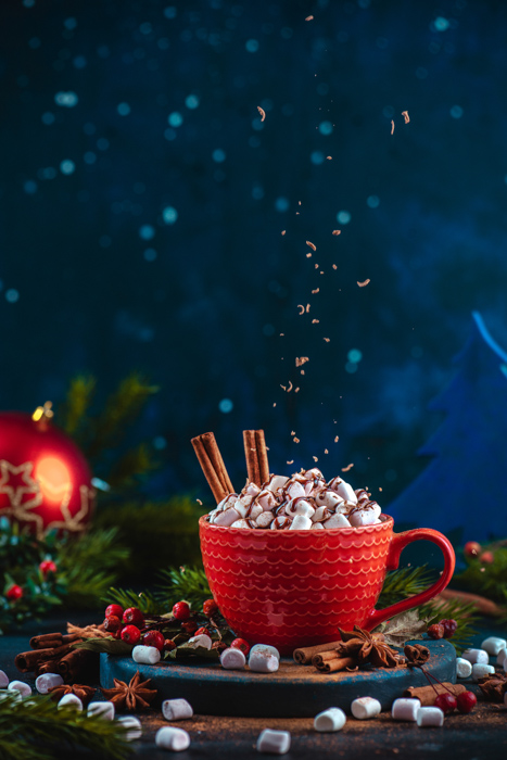 Cool Christmas photos still life of chocolate crumbs levitating over a cup of hot chocolate in a still life set up