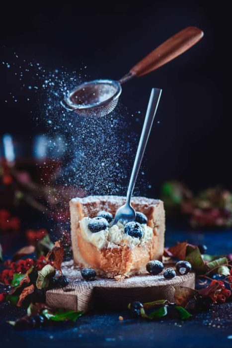 Cool Christmas photos still life of sugar and sieve levitating over a slice of cake