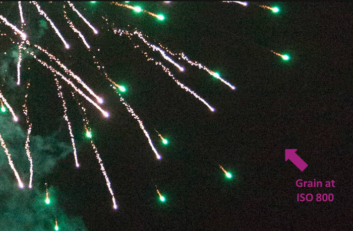 Close up of green fireworks with an arrow pointing out grain