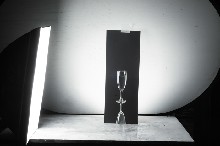 Shooting wine glass photography against a black background