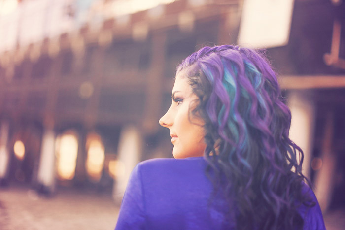 A portrait of a blue and purple haired girl - social media tips for photographers