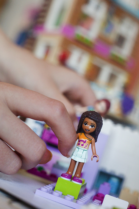 Styling a small toy figure for a toy photo shoot