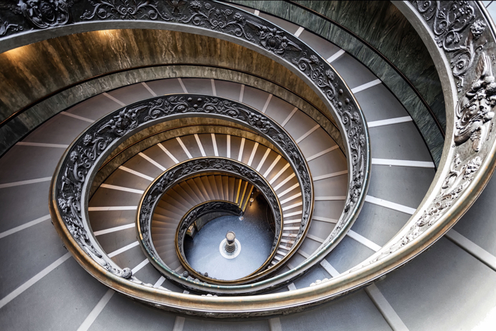 A beautiful spiral staircase in the vatican museum in rome shot using best architecture photography equipment