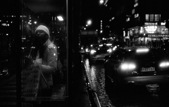 A street scene at night shot with black and white photography film