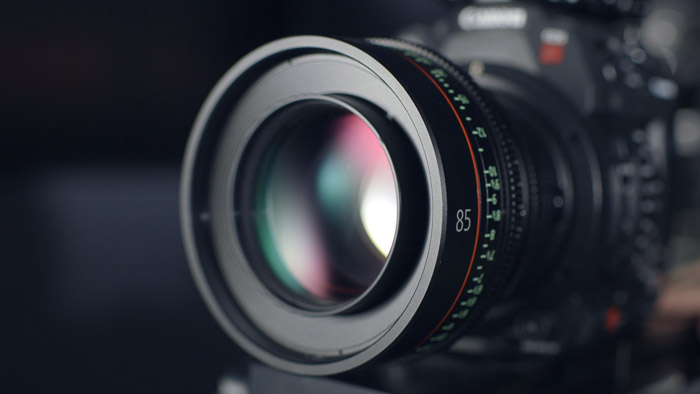 A close up of a camera lens caught from one of the best camera stores