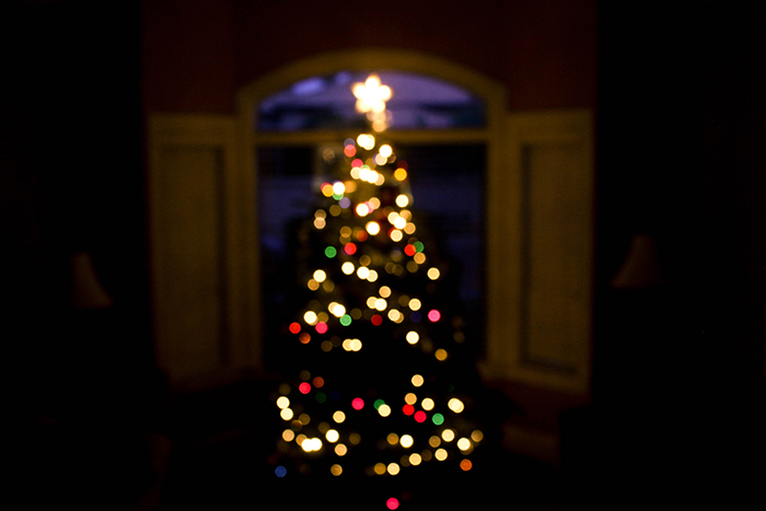 Beautiful bokeh lights on a Christmas tree in low lights