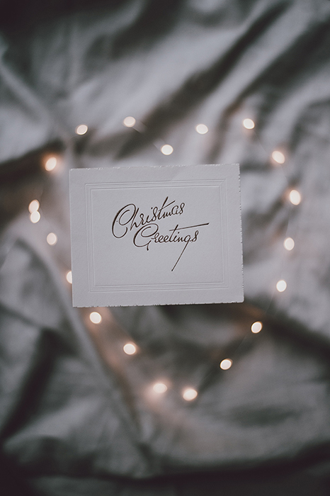 Heart shaped Christmas bokeh lights in the background of a greeting card