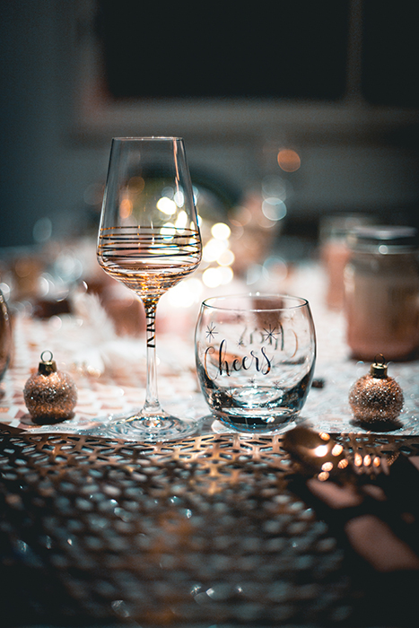 A table set for Christmas dinner with a beautiful blurry background