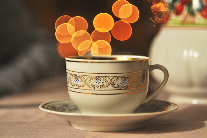 A teacup with a beautiful Christmas bokeh background