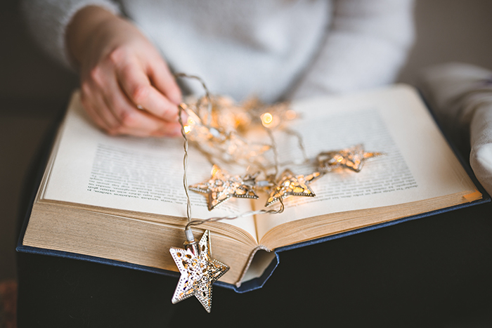 A soft, dreamy images of a person reading, beautiful christmas bokeh ideas