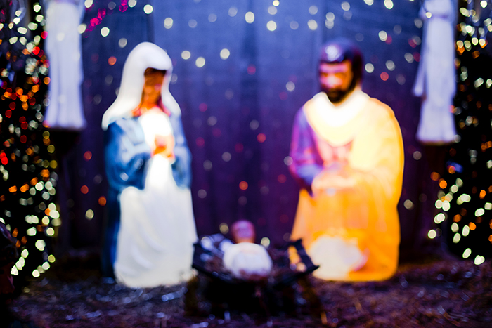 A nativity scene with Christmas bokeh background