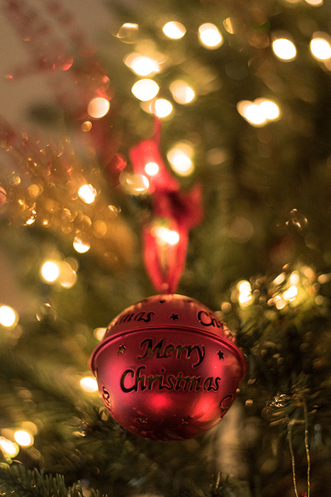 Ornaments on a Christmas tree with bokeh lights background