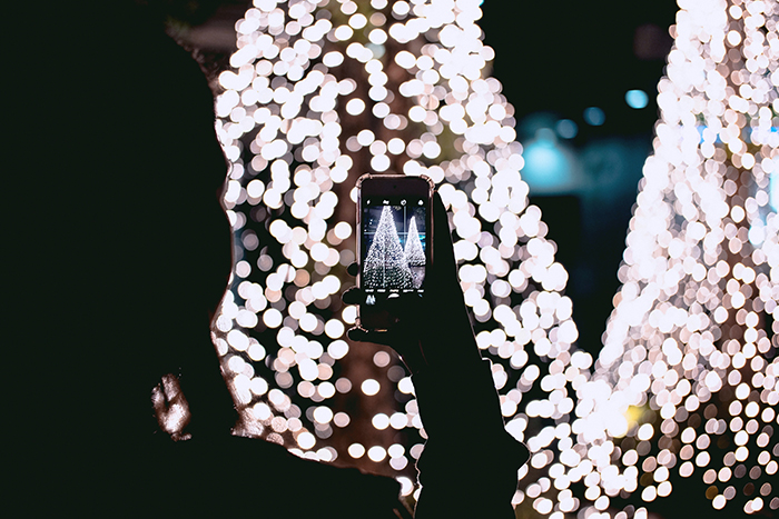 Taking a smartphone photo of a Christmas tree