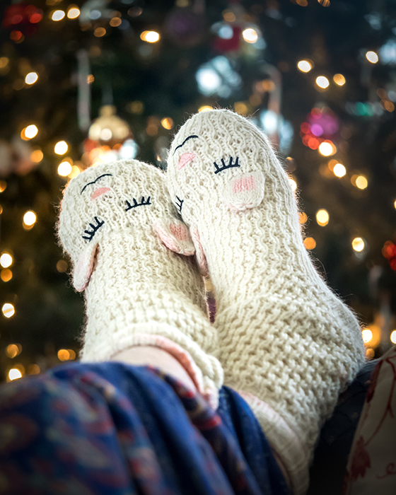 Atmospheric Christmas photography of a persons feet in cute slippers