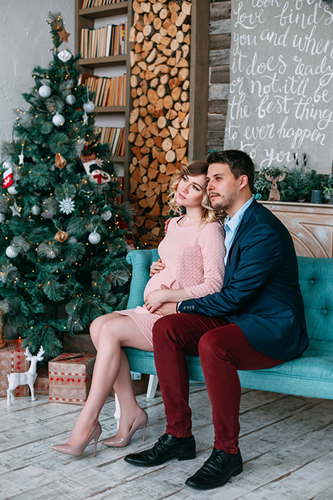 An indoor Christmas portrait of a couple