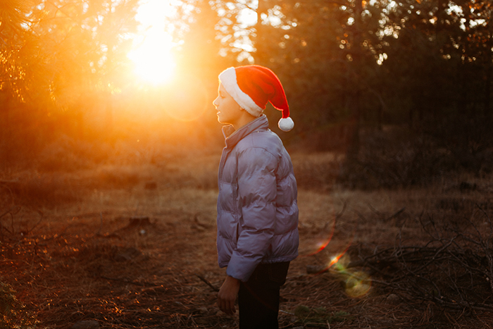 Atmospheric outdoor Christmas portrait of a little boy