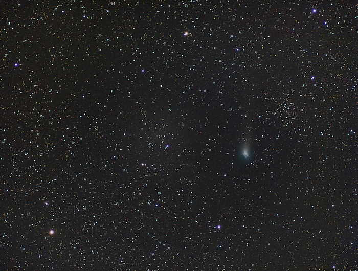 A deep sky photo with a smudgy comet