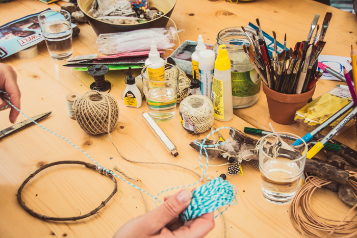 a table filled with DIY craft materials