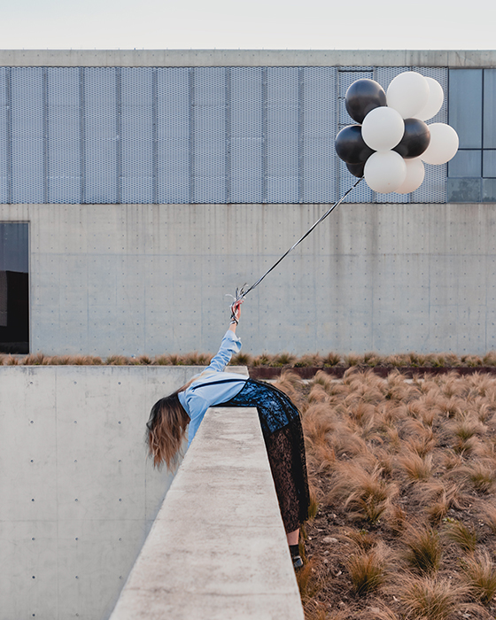 A fine art photo of a woman posing outdoors with balloons - what makes photography art
