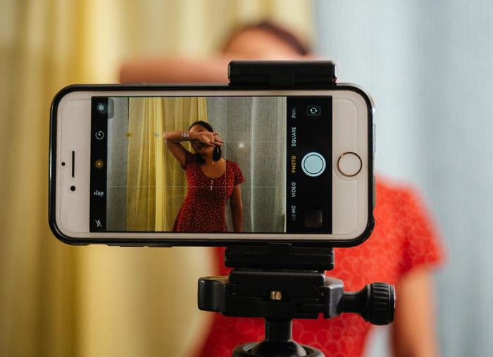 Close up of taking a smartphone selfie with an iPhone timer