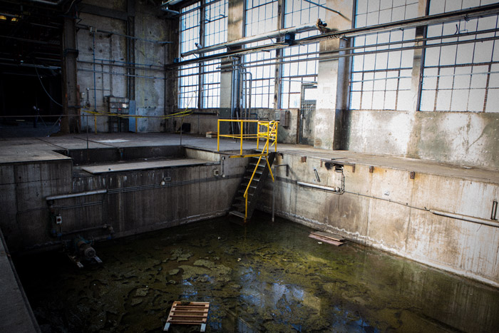 An industrial photography shot of a waste pool inside a building