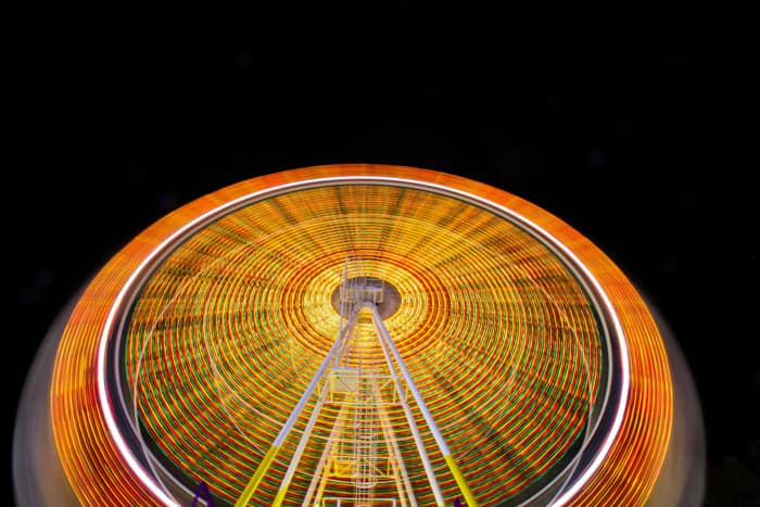 Time-lapse image of a ferris wheel at night