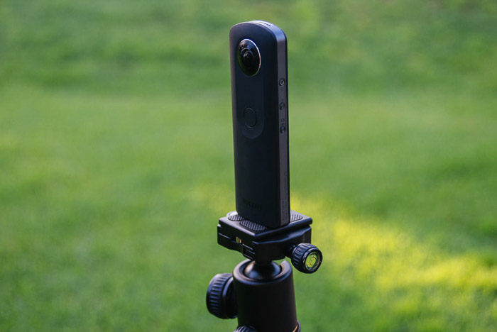 A 360 camera phone mounted on a tripod for taking sharper iPhone panoramas