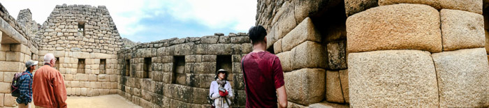 Interesting panoramic pictures of tourists observing an ancient stone building