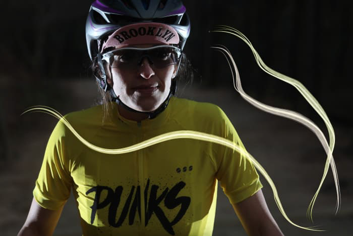 A portrait of a female athlete in low light with Photoshop Lighting effects overlayed