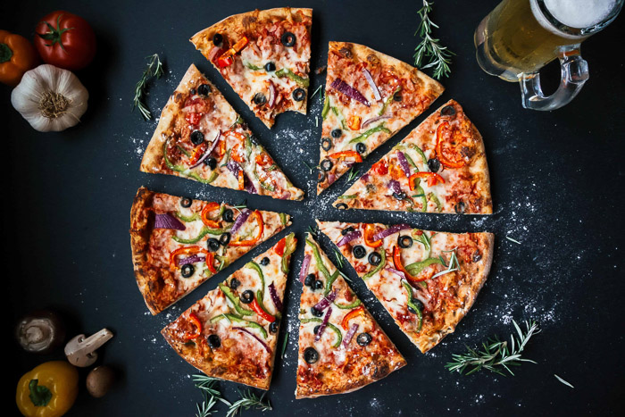 Overhead shot of a sliced pizza
