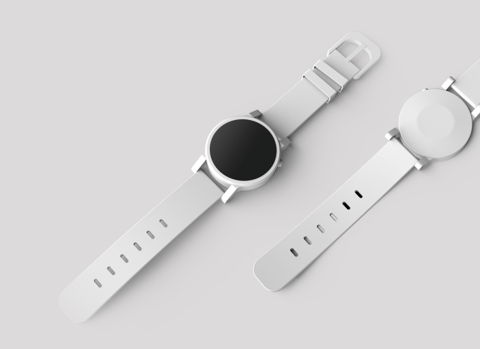 White watches on a white surface