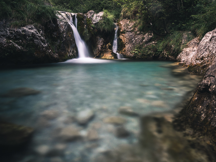 A summer photography shot of a waterfall in Val Vertova