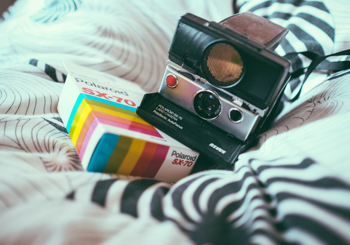 A Polaroid camera beside a box of film - where to buy film for instant camera