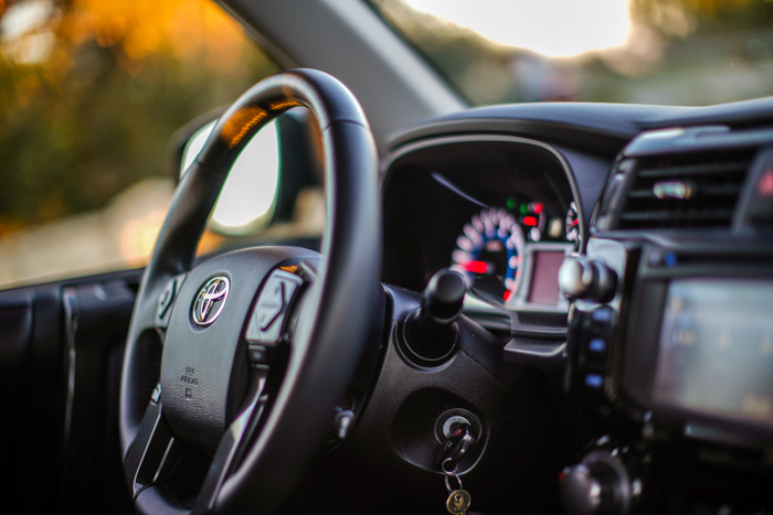 The interior of a car - steering wheel and dashboard