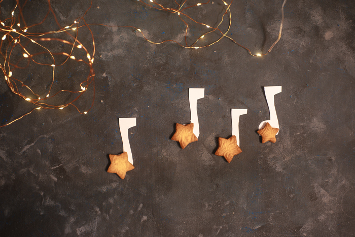 A magical Christmas still life including music notes, cookies and Christmas lights