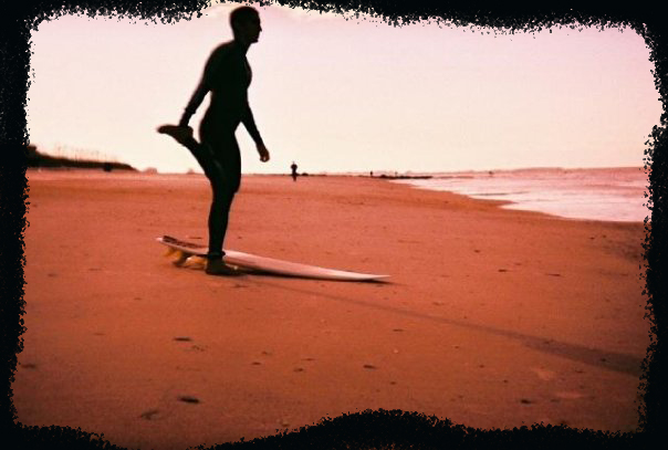 An image of a surfer on a beach with a hand painted Photoshop border