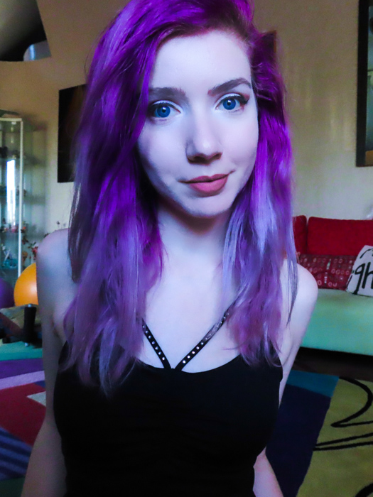 An indoor portrait of a purple haired female model, taken with canon powershot sx740 hs