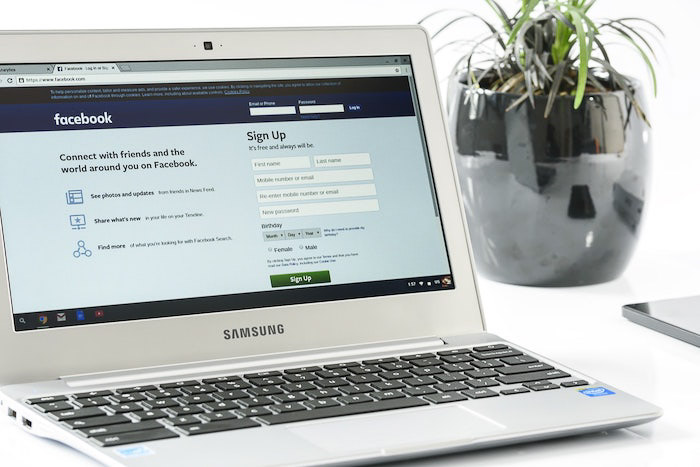A laptop opened on the facebook login page