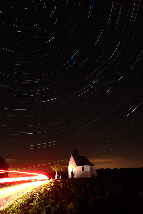 Foinal image of a night landscape with stunning star trails