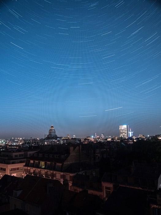 A cityscape at night, unwanted patterns in the sky visible - starstax review