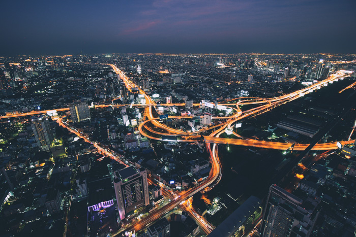Aerial view of a sprawling cityscape at night - Lightroom vs Camera Raw