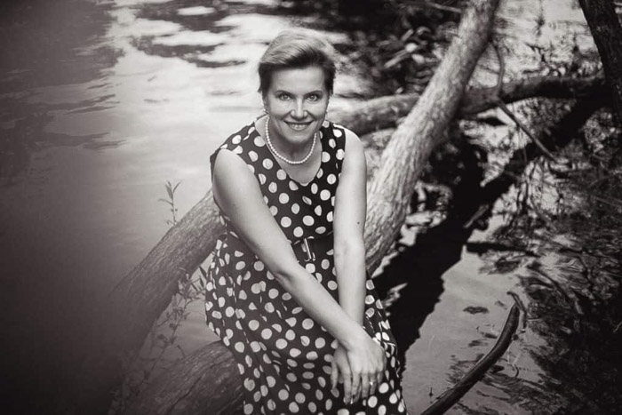 A black and white photography portrait of a woman in a polka dot dress