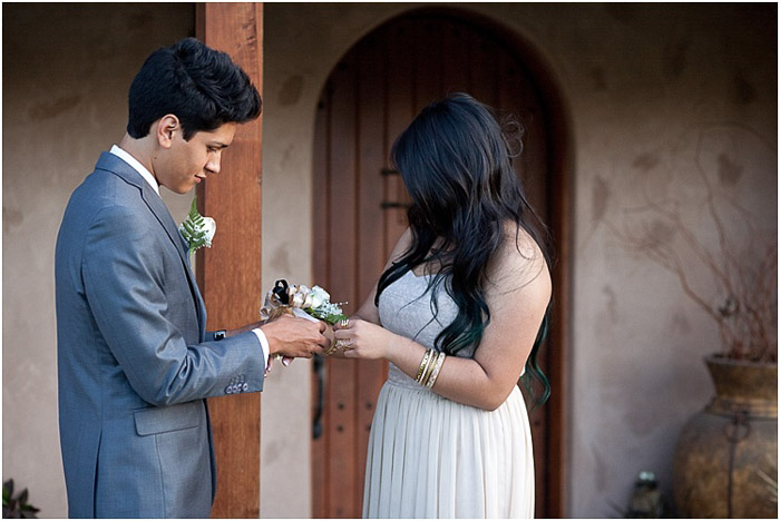 Cute prom photography of a teen couple posing outdoors