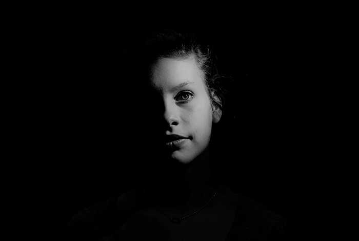 Atmospheric portrait of a female model shot with chiaroscuro lighting