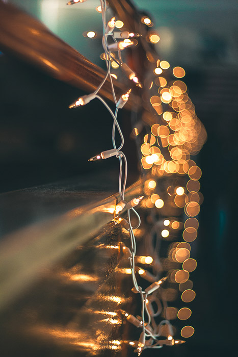 Beautiful Christmas bokeh lights in the background of a string of fairy lights