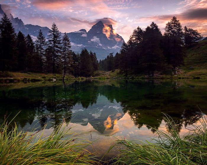 A stunning mountainous landscape with reflections in the water, shot with a CPL filter