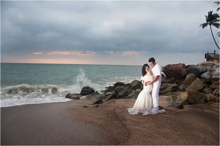 Beautiful wedding portrait of the couple posing on a beach