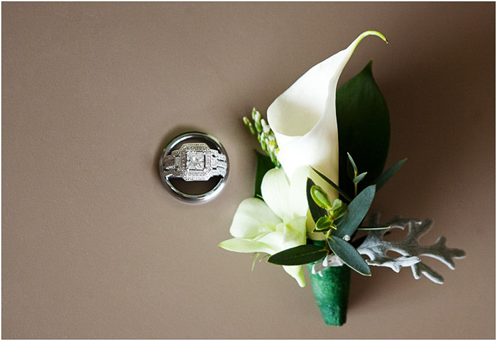 Wedding photography flat lay of an orchid beside a ring